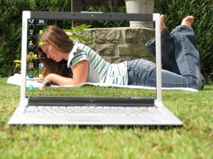 girl reading on laptop screen